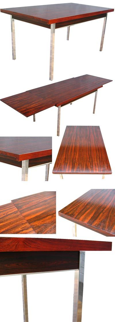 Large Merrow style, rosewood extending table. Standing on chrome feet with chrome detailing and a stunning 'Tiger' grain rosewood veneer. Extends via two pull out leaves at either end. Seating for up to 10 people.